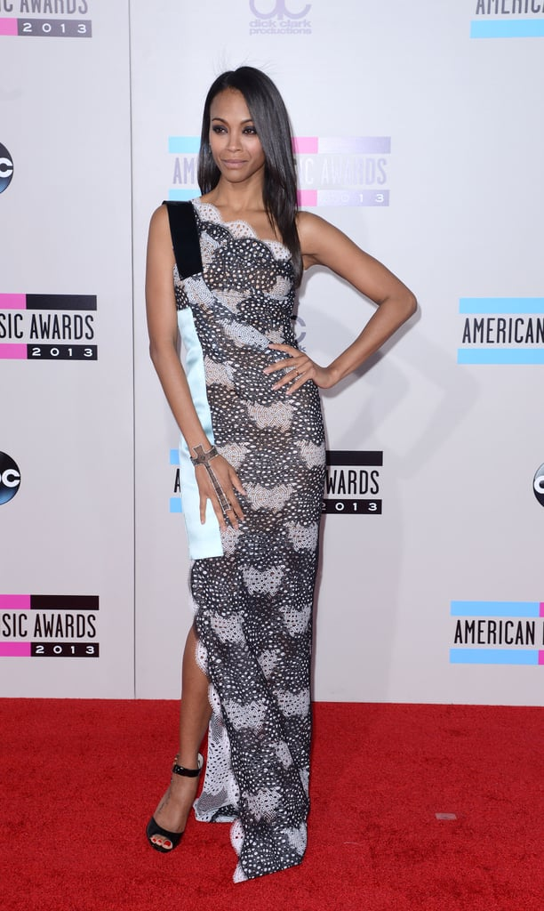 Hello, bombshell! For the 2014 American Music Awards, Saldana put her curves on display in a lacy one-shoulder Roland Mouret gown.