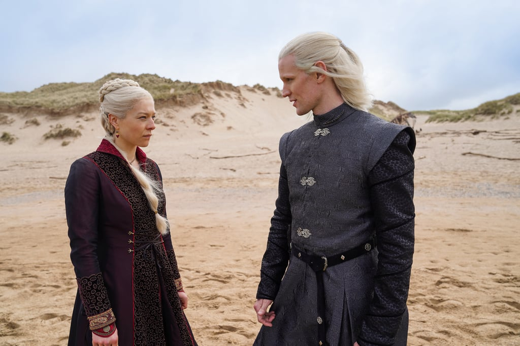 """It's been almost two years since the Game of Thrones prequel series House of the Dragon was first announced, and now we finally have the first look. On Wednesday, HBO shared photos of the cast in character. While Emma D'Arcy and Matt Smith — who are playing Princess Rhaenyra Targaryen and Prince Daemon Targaryen — can be seen sporting the Targaryen's signature blonde hair, we also get glimpses of Steve Toussaint as Lord Corlys Velaryon, aka """"The Sea Snake,"""" as well as Olivia Cooke and Rhys Ifans as Alicent Hightower and Otto Hightower, respectively.  The upcoming series is based off of George R. R. Martin's 2019 novel Fire & Blood and will focus on House Targaryen. Set hundreds of years before the events of Game of Thrones, this prequel will chronicle the rise and fall of the troubled Targaryen dynasty. With production currently underway, the series is expected to debut on HBO in 2022. In the meantime, get a first-look at the series ahead.      Related:                                                                                                           Could HBO Be Remaking That Disappointing Game of Thrones Finale? Fans Sure Hope So"""