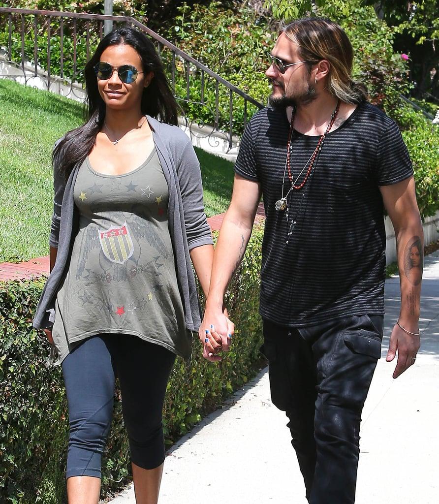 Zoe Saldana and her husband, Marco Perego, took a stroll around their LA neighborhood on Monday.