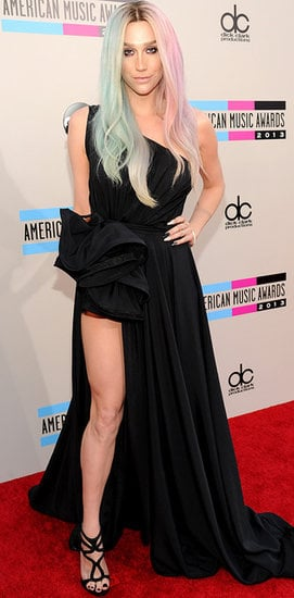 Don't let the rainbow hair fool you — Ke$ha was feeling romantic goth at the American Music Awards in a strapless black dress with a full skirt and a sultry slit. The dramatic dress would be perfect for a black-tie event and is so different than the glitter grunge of her past, we can hardly believe it's the same girl.