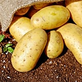 Store an apple with your potatoes