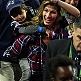 Gisele waved to the crowd with Benjamin on her back.