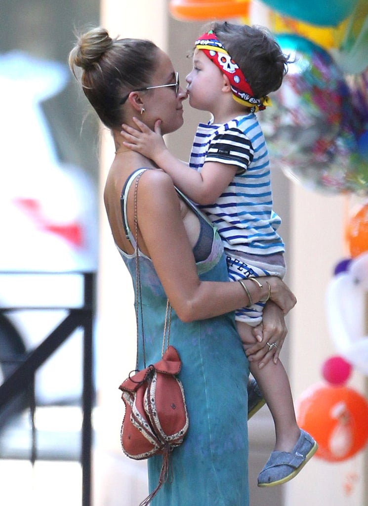 Nicole Richie got a kiss on the nose from her son, Sparrow, at a birthday party in LA.