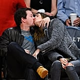 Mark Wahlberg and Rhea Durham shared a passionate kiss while sitting courtside at the LA Lakers vs. Milwaukee Bucks game in LA on Friday.