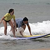 They surfed side by side during one of their Hawaiian vacations in June 2007.
