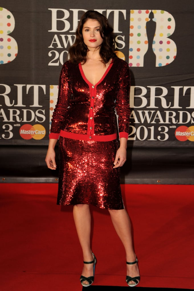 Gemma Arterton shimmered in a red sequined cardigan and matching skirt at the 2013 Brit Awards.