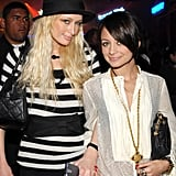 A dark-haired Nicole stuck close to her pal Paris Hilton during an LA soirée in November 2006.