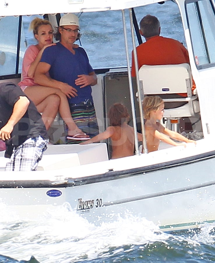 Britney Spears continued her mini--vacation on Long Island with an afternoon of boating yesterday. She affectionately held onto her boyfriend Jason Trawick while her sons Jayden James and Sean Preston played down on the deck. On Wednesday, Jason and Britney brought her sons to the beach and an ice cream truck. Britney is back in business on tour tonight in New Jersey, and she continues nonstop through August. Brit then has a month break, which hopefully means an appearance at the VMAs where she has two nominations, before embarking on her European and South American tour in the Fall. It was just announced that Britney will have a new tour partner in Joe Jonas when she heads abroad in September.