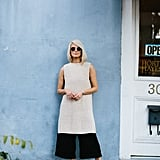 Play with proportions by layering a longline sweater over culottes and add flats.