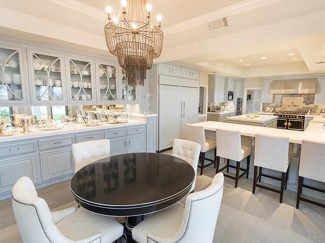 Michelle opted for pieces that combine deco and whimsy, like this bronze chandelier in the kitchen.