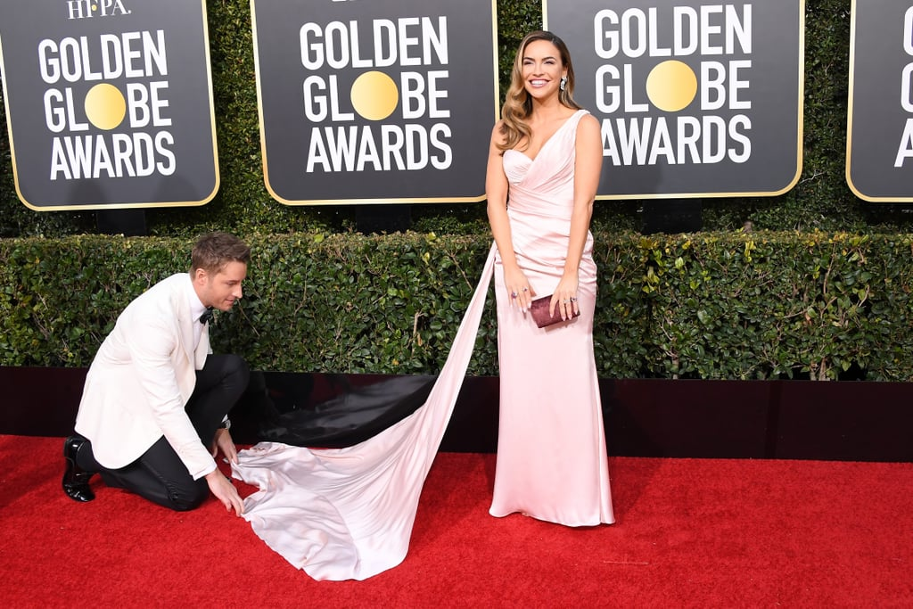 Justin Hartley makes us swoon every Tuesday night with his role as Kevin on This Is Us, but his role as husband might be our favorite. During the Golden Globes on Sunday night, the actor made our hearts flutter as he walked the red carpet with his wife Chrishell Stause. While posing for the cameras, Justin stopped what he was doing to help Chrishell properly bustle the flowing train on her dress. Total Jack Pearson move!       Related:                                                                                                           You'll Feel Like a Fly on the Wall Scrolling Through These Golden Globes Photos