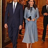 Kate Middleton's first public appearance after her third pregnancy announcement was on Oct. 10 for World Mental Health Day. The royal attended a reception at Buckingham Palace wearing a light blue Temperley London dress. The lace look stayed true to her feminine style, and Kate continued her pattern of matching her shoes with her clutch.