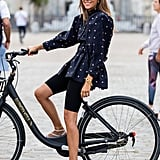 Go ladylike on top and sporty on the bottom by styling your athletic bike shorts with a puffy peplum statement top.