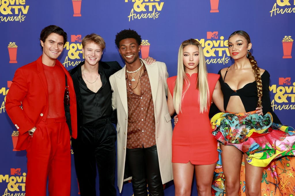 """The Pogues did not come to play when they showed up to the MTV Movie and TV Awards in LA on Sunday. Dressed in colorful coordinating ensembles, the Outer Banks cast — Chase Stokes, Rudy Pankow, Madison Bailey, Madelyn Cline, and Jonathan Daviss — looked good as hell as they reunited on the red carpet ahead of the ceremony. The group, who recently wrapped filming season two of the Netflix series, presented at the show, while real-life couple Madelyn and Chase took home the golden popcorn for best kiss. The cast's exciting reunion comes just days after Netflix announced Outer Banks will be returning for season two this summer. """"Season 2 is going to test our crew like never before. We've turned up the dial on everything fans loved about season one — more mystery, more romance and higher stakes. It's a full throttle, action-packed adventure and these photos offer a glimpse into the next chapter for our Pogues,"""" the show's creators and executive producers, Jonas Pate, Josh Pate, and Shannon Burke, said in a statement. """"All we can say for now is buckle up, it's going to be a wild ride."""" Ahead, see more of the cast's night out at the MTV Movie and TV Awards.      Related:                                                                                                           The Current Relationship Statuses of the Outer Banks Cast — Who's Single and Who's Taken?"""