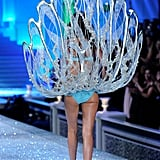Miranda Kerr walked with oyster-shell wings.