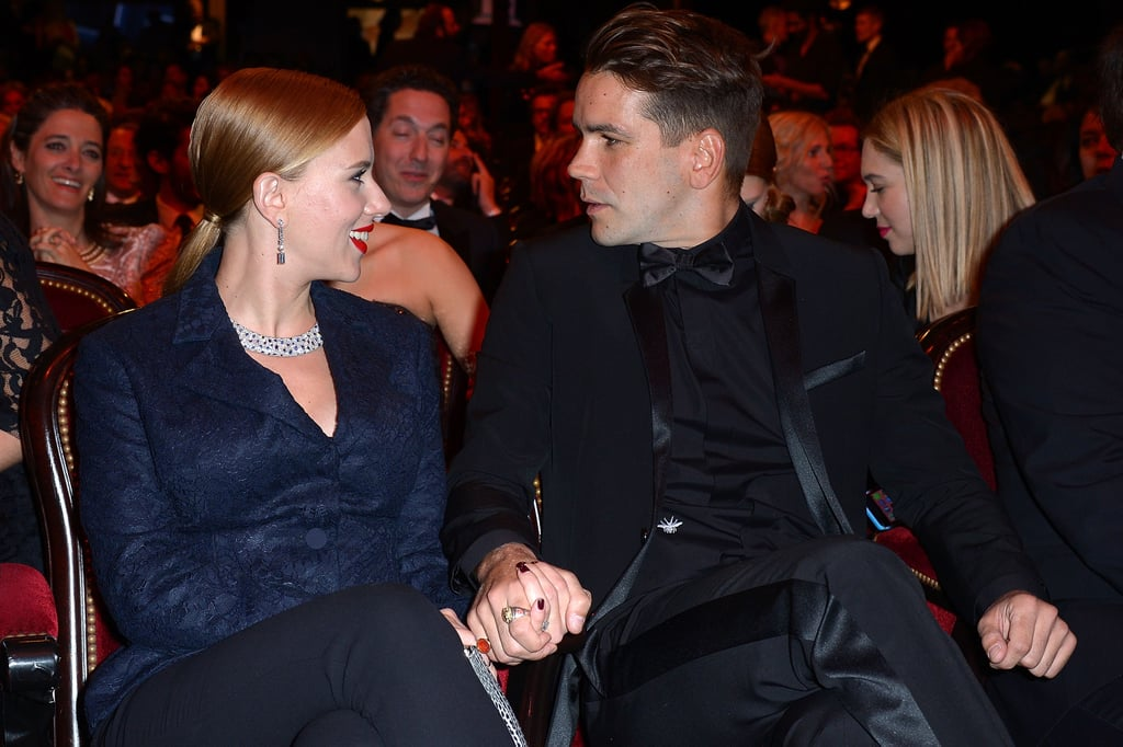 Scarlett shared a smiley moment with Romain at the César Awards in Paris in February 2014.