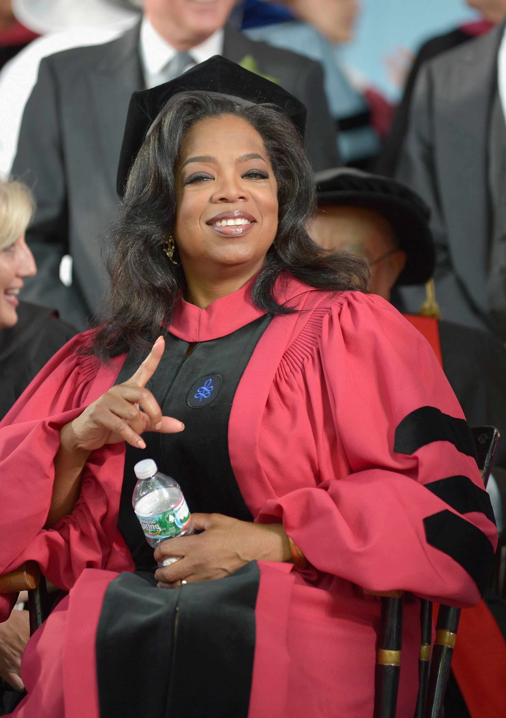 Oprah pointed from her seat while receiving an Honorary Doctor of Laws degree at Harvard University in 2013.