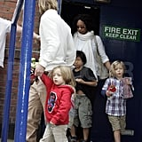 Knox Jolie Pitt and Shiloh Jolie-Pitt leave a theater in London with Pax Jolie-Pitt and dad Brad Pitt.