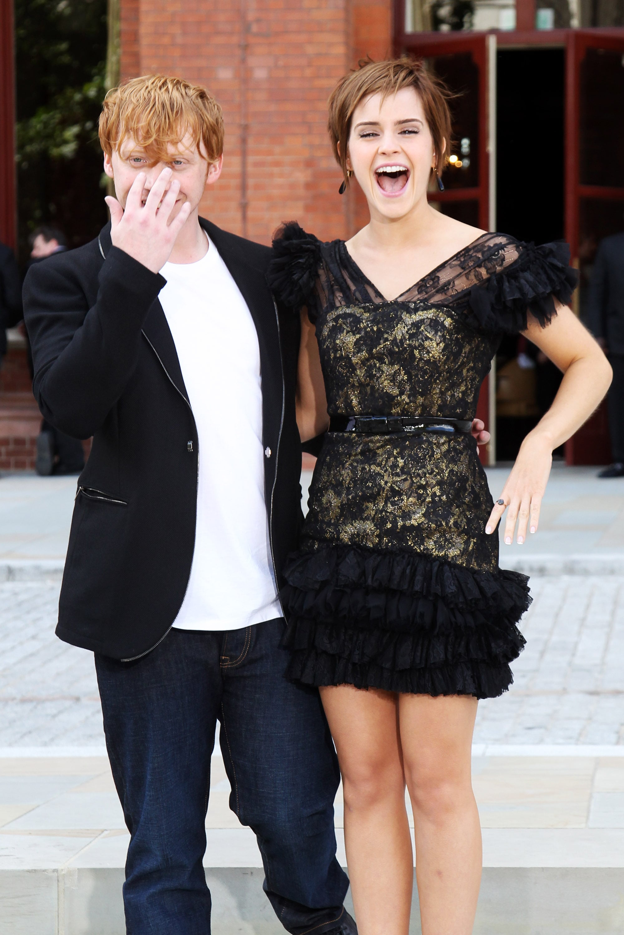 The photographers got a big laugh out of Rupert and Emma.