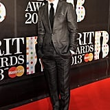 Justin Timberlake posed in a grey suit.