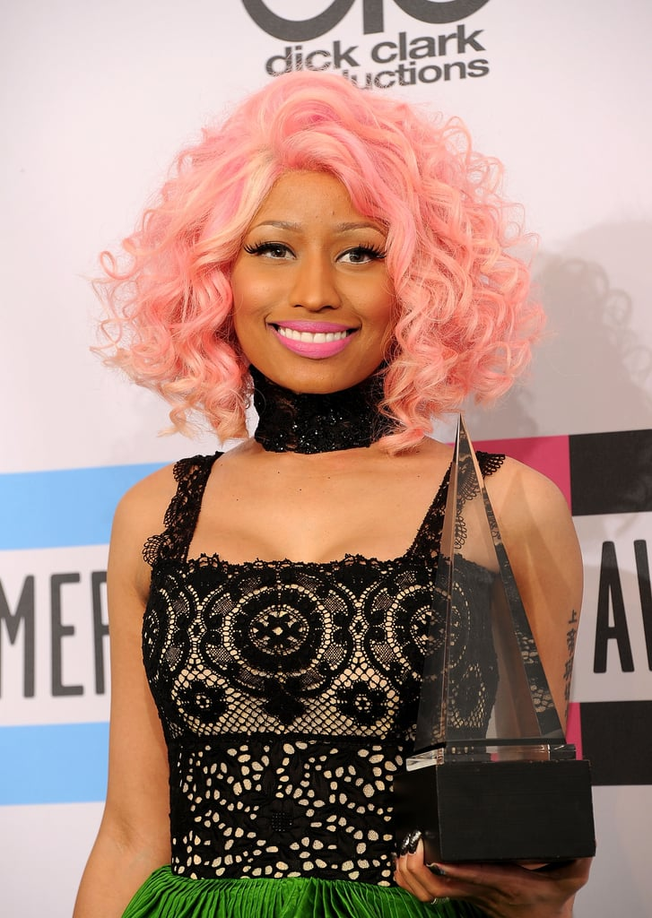 Nicki Minaj smiled with her American Music Award.