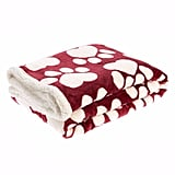 Pet Holiday Heart Paw Pet Throw Blanket ($30) PetSmart will donate 10 percent of the sale of this item to PetSmart Charities in the US or PetSmart Charities of Canada to help save homeless pets.