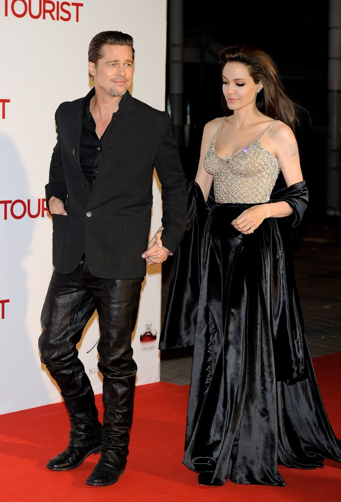 Angelina Jolie had Brad Pitt on her arm as she joined Johnny Depp at tonight's Madrid debut of The Tourist. She and Johnny were together again after kicking off the day with a photo call. The onscreen pair were both surprisingly nominated for Golden Globes due to their work in the movie, though they didn't receive any nods at this morning's Screen Actors Guild Awards announcement.  The beaded top and long, black skirt Angelina chose today is just one of several dramatic looks she's worn during the European press tour, while Johnny has chosen to stick to his signature casual style.