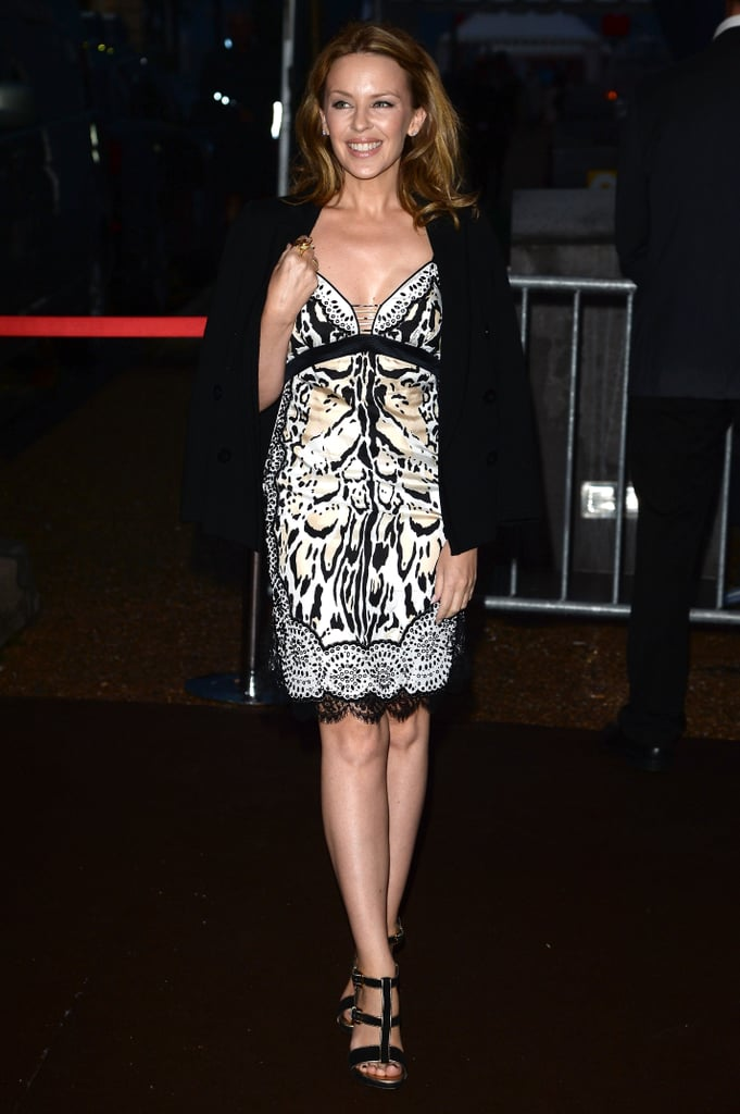 Kylie Minogue added a black blazer to this printed frock at the Roberto Cavalli yacht party.