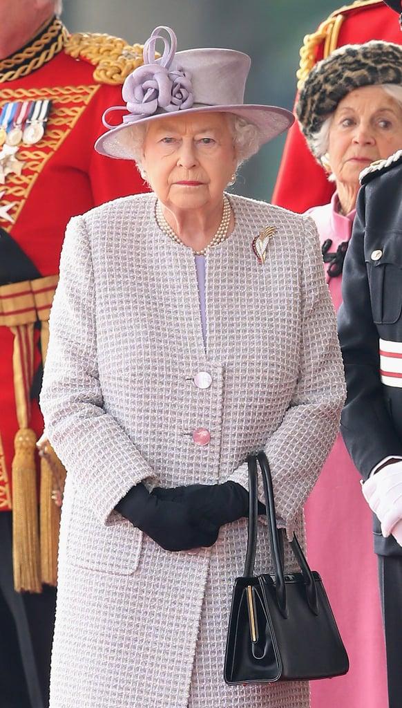 Queen Elizabeth Wearing Purple Tweed Coat