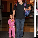 Matt Damon held hands with daughter Stella arriving at the airport in Boston.