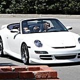 Posh Drives Kids Around in Coupe