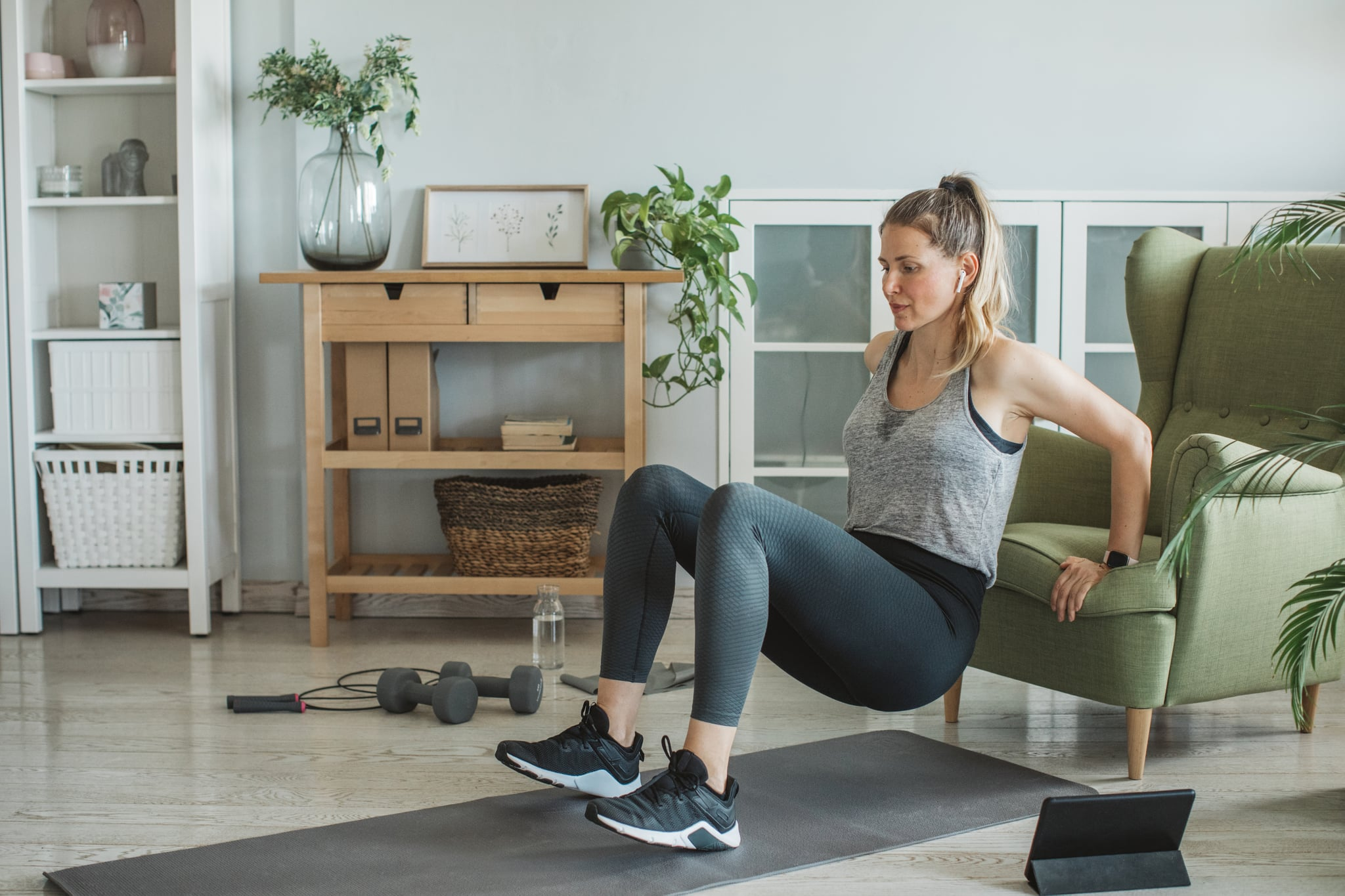 Women at home during pandemic isolation doing workout to stay in shape