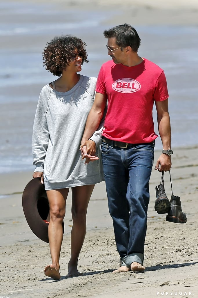 Halle Berry and Olivier Martinez held hands during a romantic stroll along the Malibu, CA, shore in May 2012.
