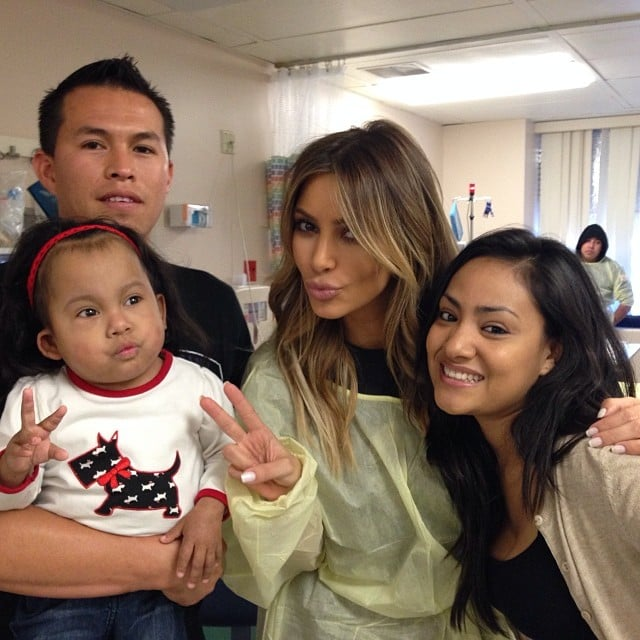 Kim Kardashian posed with people at the LA Children's Hospital on Christmas Eve. Source: Instagram user kimkardashian