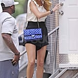 Blake Lively with a blue Chanel purse on the set of Gossip Girl.