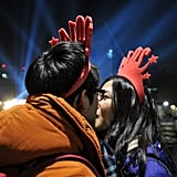 This cute couple kissed in their festive hats in Seoul, South Korea.