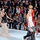 Orlando Bloom snaps a photo of Miranda Kerr on the runway!