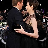 Anne Hathaway and her Les Mis director Tom Hooper hugged  in the audience.