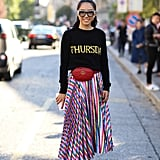 Wear One With a Graphic Sweater and a Colorful Midi Skirt