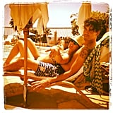 The couple got close in their bathing suits.  Source: Instagram user Norman Cook