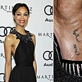 "Zoe Saldana's right foot tattoo is Arabic and apparently means, ""I want to ask her."""