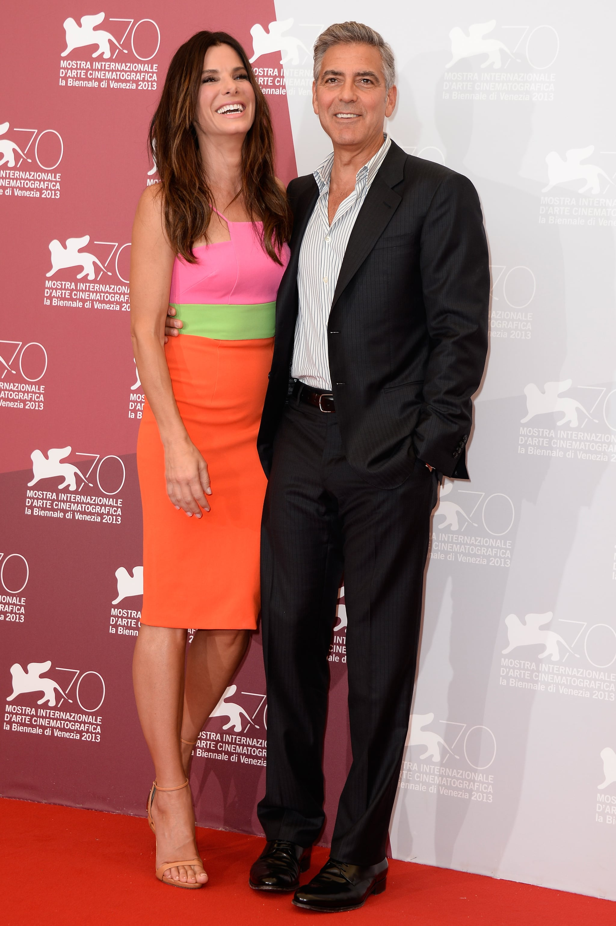 George Clooney and Sandra Bullock posed at the photocall for their film, Gravity, in Venice.