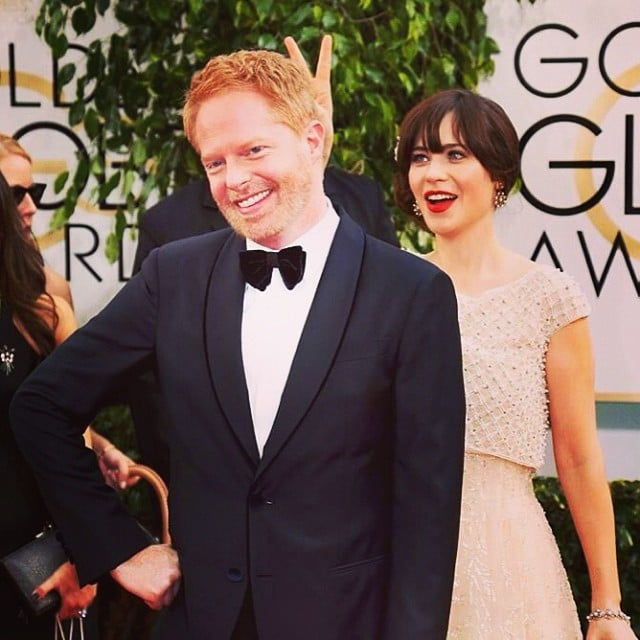 Zooey Deschanel gave Jesse Tyler Ferguson rabbit ears on the red carpet. Source: Instagram user jessetyler