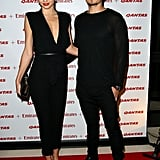 Orlando Bloom and Miranda Kerr hand their arms around each other at the event.