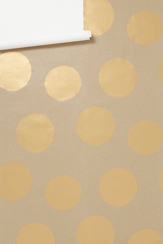 Maybe it's time to spruce up my bathroom with this gold polka-dot wallpaper ($198). — Annie Scudder, editor