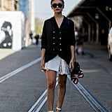 A Blazer Adds Sophistication to Pleats and Dainty Heels