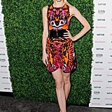 Jaime King's bright printed minidress got an even cooler touch thanks to her wide black belt.