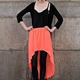 A pretty sorbet skirt livened up an all-black look.