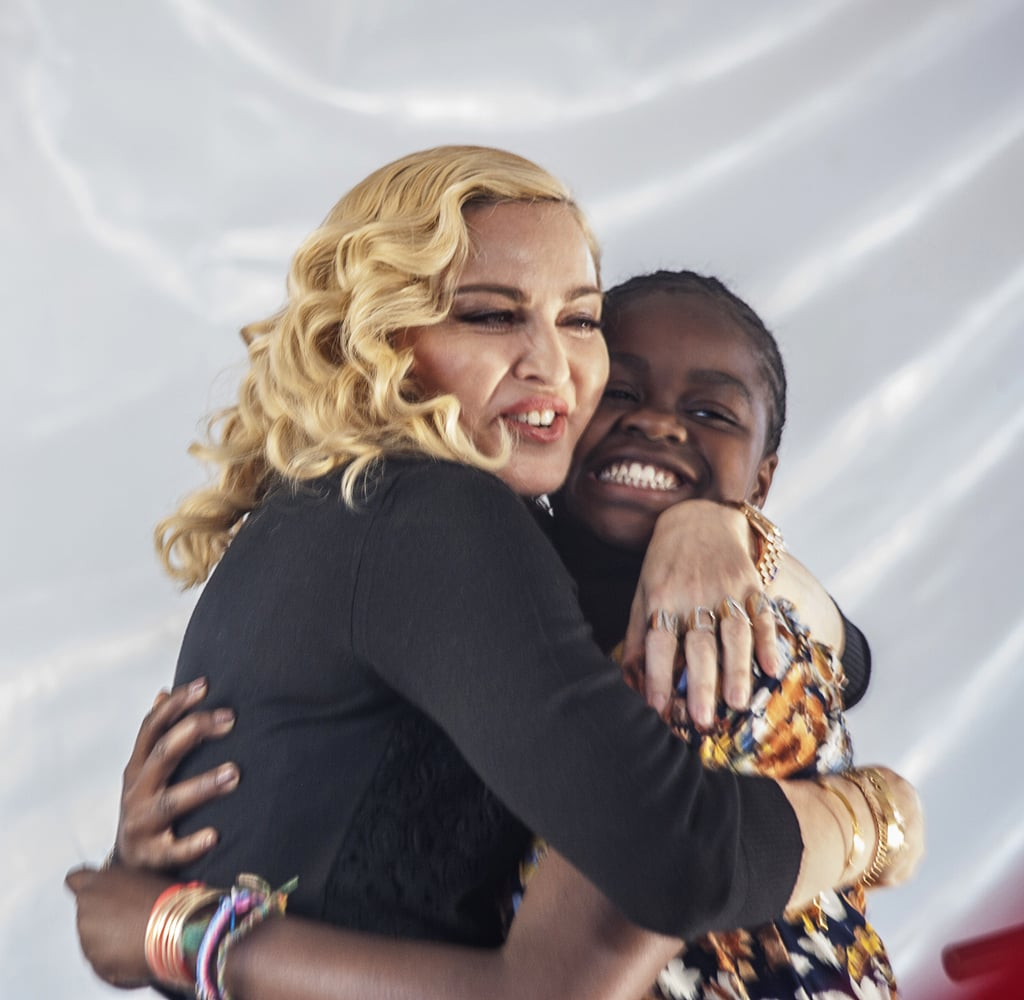 """Madonna had five of her six children, sons Rocco and David and daughters Mercy, Estere, and Stelle by her side for the opening ceremony of the Mercy James Institute for Pediatric Surgery and Intensive Care at Queen Elizabeth Central Hospital in Blantyre, Malawi, on Tuesday. The singer took her four adopted kids back to their home country to celebrate the new pediatric-surgery wing, which was funded by her Raising Malawi charity and named after her 11-year-old daughter; Mercy addressed the crowd with a speech — calling her famous mom """"the bomb"""" — and Madonna sweetly rested her head on David's head in their seats. Madonna also addressed the audience with a heartfelt speech about her history with Malawi: """"There are so many things I never imagined I will do. I never imagined one day I will build this kind of a hospital,"""" she said, explaining that growing up without a mother herself has motivated her to give the best to Malawian children. She added: """"Never give up on your dreams.""""  Madonna adopted 11-year-old David and Mercy in 2006 and 2007, respectively, and welcomed twins Estere and Stelle, 4, in February. President Peter Mutharika bestowed the pop star with a huge honor during the ceremony, declaring, """"You started by adopting four Malawian children, now we are adopting you as the daughter of this nation."""""""