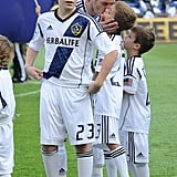 David gave Romeo a smooch on the field before an LA Galaxy game in December 2012.